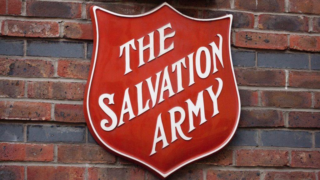 Salvation ARmy logo on brick wall