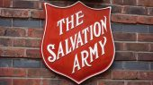 Salvation ARmy logo on brick wall